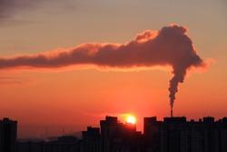 Smoke from industrial chimneys at dawn