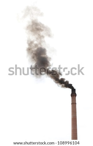 Smoke from smokestack chimney of a traditional rice mill polluting the environment.