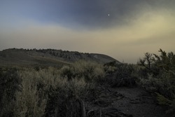 Smoke from the Creek Fire blankets the Owens Valley and obscures the eastern escarpment of the Sierra Nevada at dusk