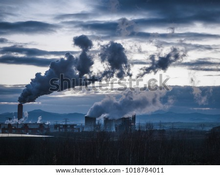 Smoke from the factory pipes. Ecological problem, mining enterprise with smoke stacks. Dirty smoke on the sky. Environmental issues. harmful emissions. Bad ecology. #1018784011