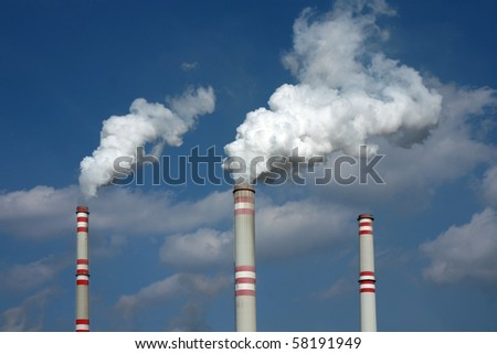 smoke from three coal power plant chimney