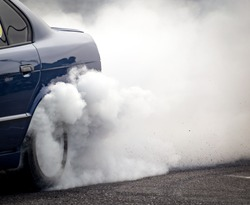 Smoke from under the wheels of the car