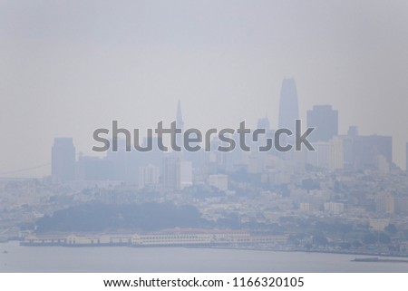 Smoke from wildfires causes hazy conditions over San Francisco skyline on sunny day