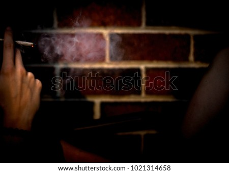smoke in front of brick wall #1021314658