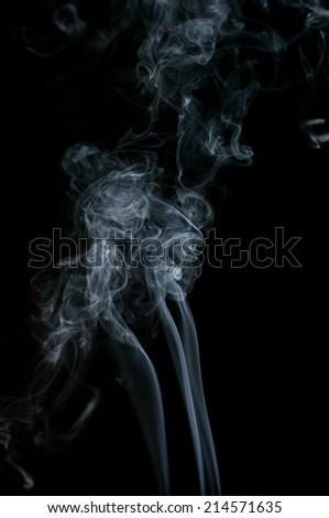 Smoke, in studio photography, black background