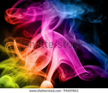 Smoke in the maelstrom of the rainbow on a black background.