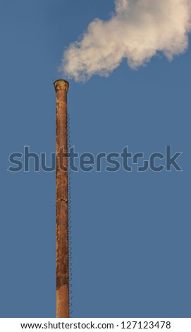 Smoke is coming from a pipe