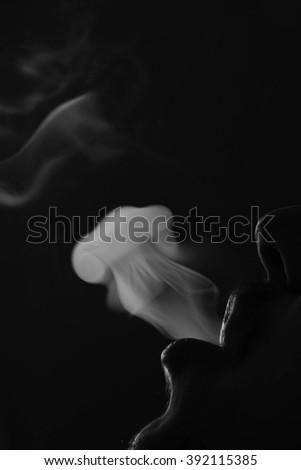 Smoke like a jellyfish on a dark background #392115385