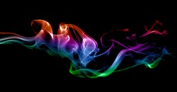 Smoke multicolored on black background.