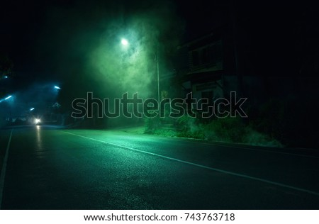 Smoke near street light on public road with old abandoned house background in Trang Thailand. Horror scene