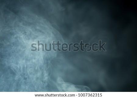 Smoke on black background - Shutterstock ID 1007362315
