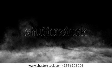 Smoke on the floor . Isolated black background.