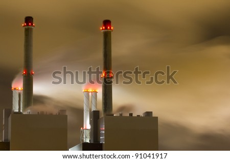 Smoke originating from a large power-station seen at night