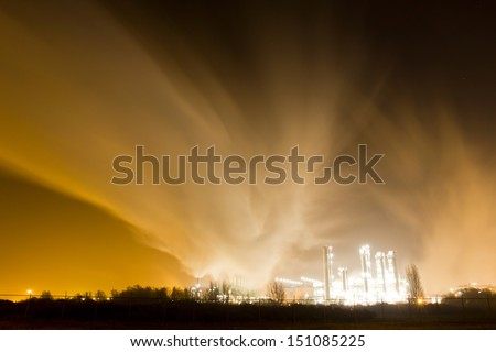 Smoke originating from a petrochemical plant at night