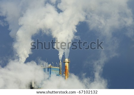 smoke produced by the smokestacks of a paper mill