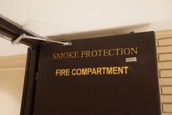 Smoke protection , fire compartment door with self-closer system at corridor for safety in the building.