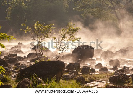 Smoke rising from hot springs in Northern of Thailand.