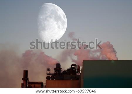 Smoke stack and eavning moon
