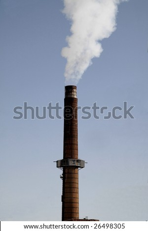 smoke stack emitting green house gasses,that are polluting our environment