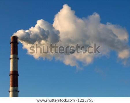 smoke stack on a blue sky background