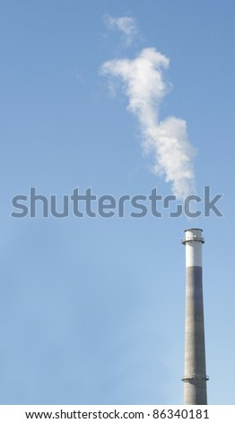 Smoke Stack on a Clear Blue Sky with Smoke.