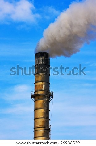 Smoke Stack with Pollution Plume Against Blue Sky