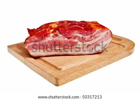 Smoked bacon on wooden board isolated over white background.