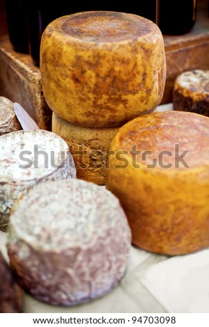 Smoked cheese wheels on the table