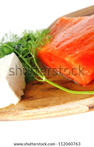 smoked fresh salmon piece with olives and white cheese