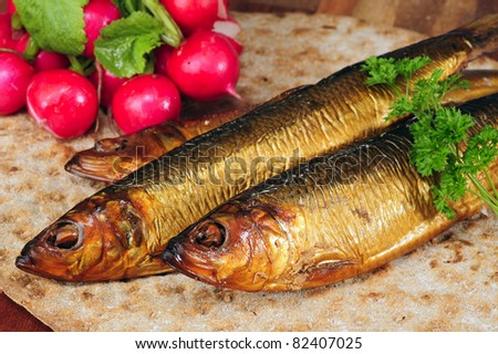 Smoked herring on crispbread, decorated with radishes and parsley.