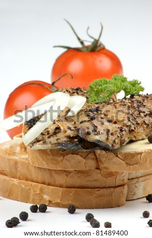 smoked mackerel fillet on toast with pepper and tomato - stock photo