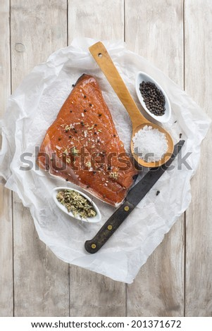 Smoked marinated salmon and ingredients on the kitchen table