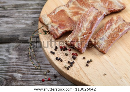 Smoked pork ribs on a wooden board