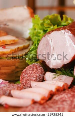 smoked pork, sausage and green salad.