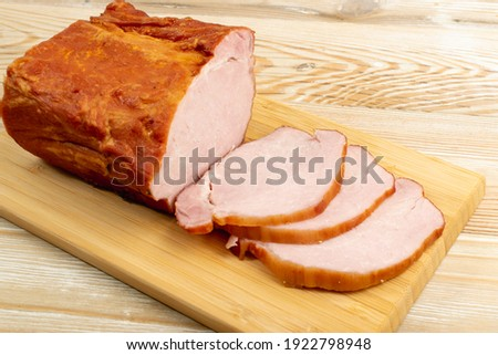 Smoked pork tenderloin, sliced ham, meat fillet on wooden table background Photo stock ©
