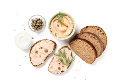 Smoked salmon and soft cheese spread  pate with brown bread and capers isolated on white background.