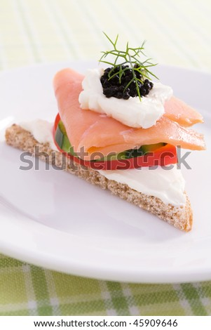 Smoked salmon canape on rye bread with cream cheese, red bell pepper ...