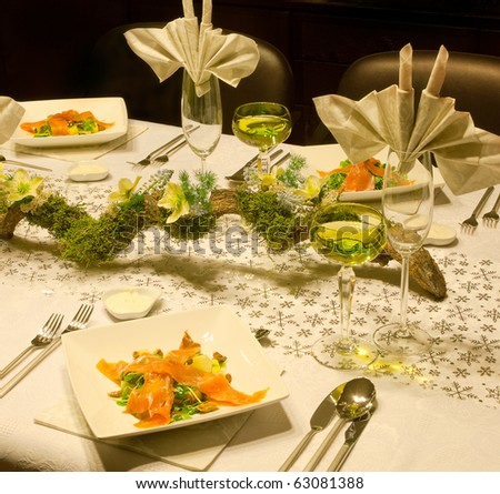 Smoked salmon dish on a festive table with flower arrangement