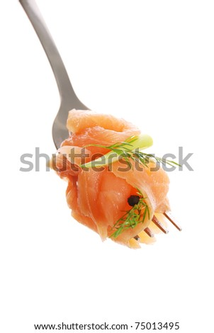 smoked salmon on a fork, isolated white background