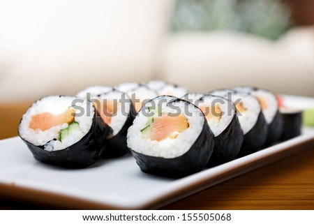 Smoked salmon rolls served on a plate