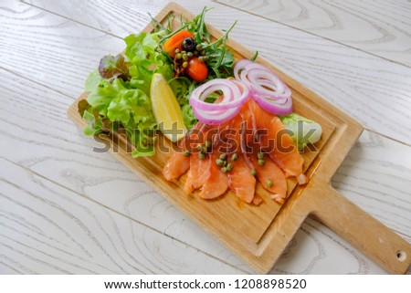 Smoked salmon salad is highly nutritious and nutritious diet. Because of meat Vegetables and herbs Suitable for all meals. #1208898520