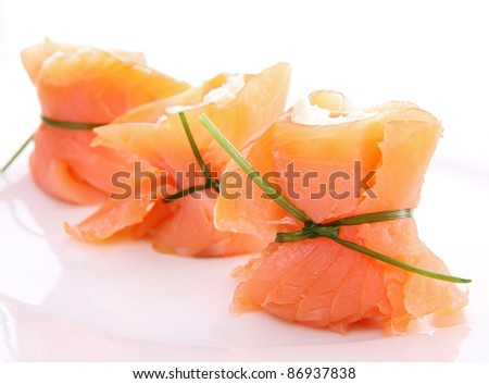 smoked salmon with cheese on white background