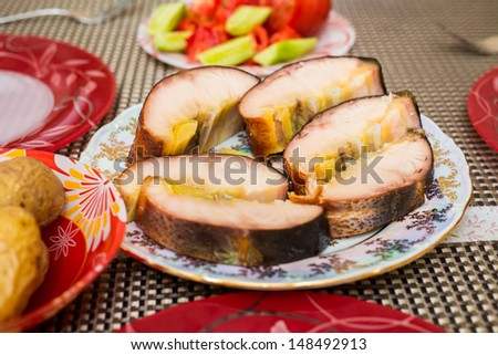 Smoked sturgeon fillets on a plate