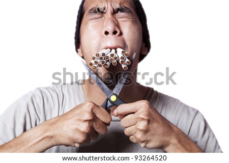 Smoker cutting his cigarette to quit smoking