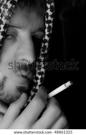 Smoker. Man with a cigarette