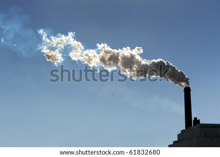 Smokestack billowing smoke into the atmosphere