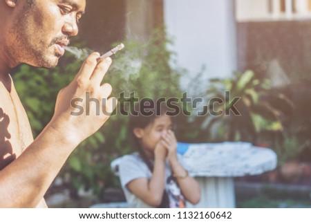 Smoking a cigarette. passive smoking concept