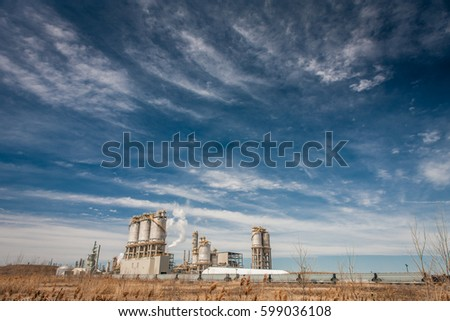 Smoking chimney of industrial buildings complex #599036108