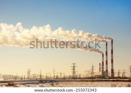 Smoking chimneys against the blue sky