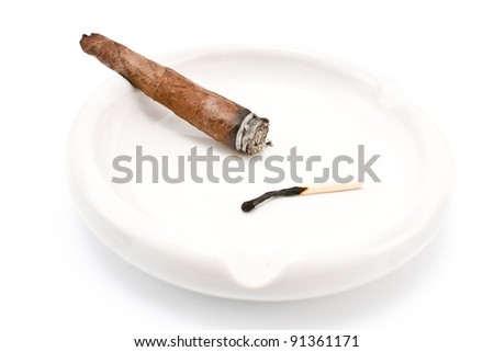 Smoking cigar in an ashtray isolated on  white